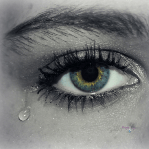 beautiful lady's eye with single tear running down side of face.-Living with depression in marriage blog post