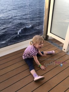 Cruising with toddlers -toddler on balcony