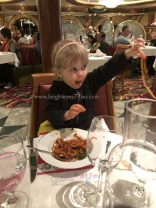 Cruising with toddlers - toddler eating spaghetti